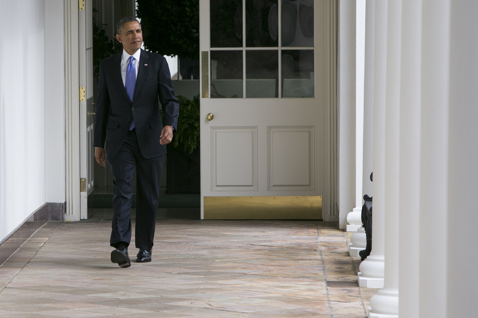 President Obama walks along the colonnade of the White House earlier on Tuesday.  (Getty Images)