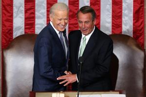 Biden and Boehner shake hands.