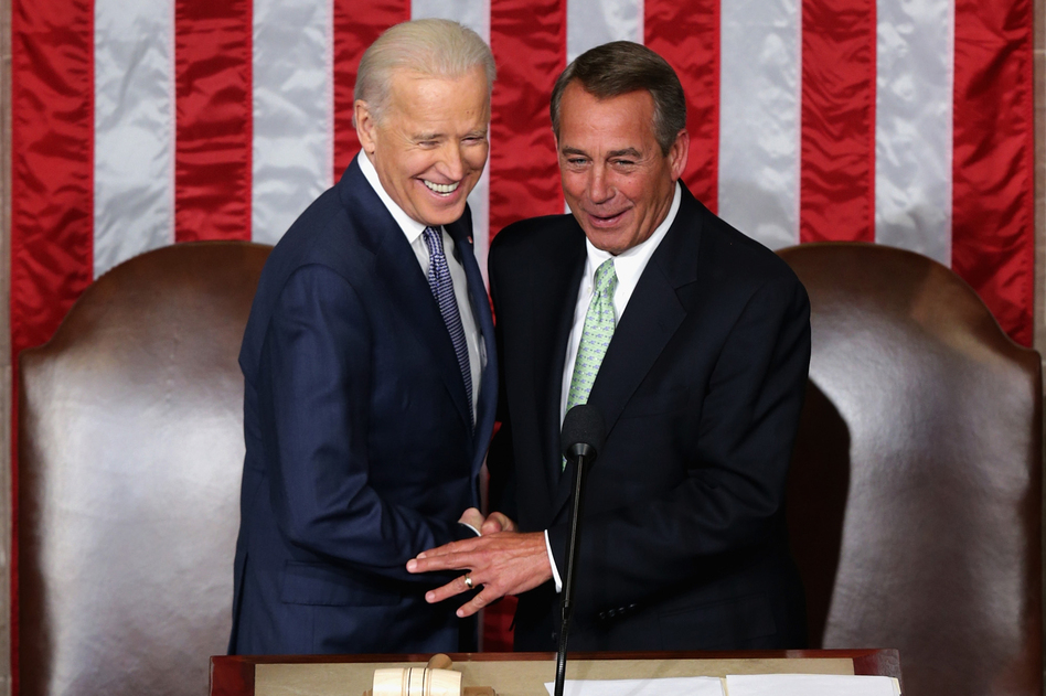 Biden and Boehner shake hands. (Getty Images)