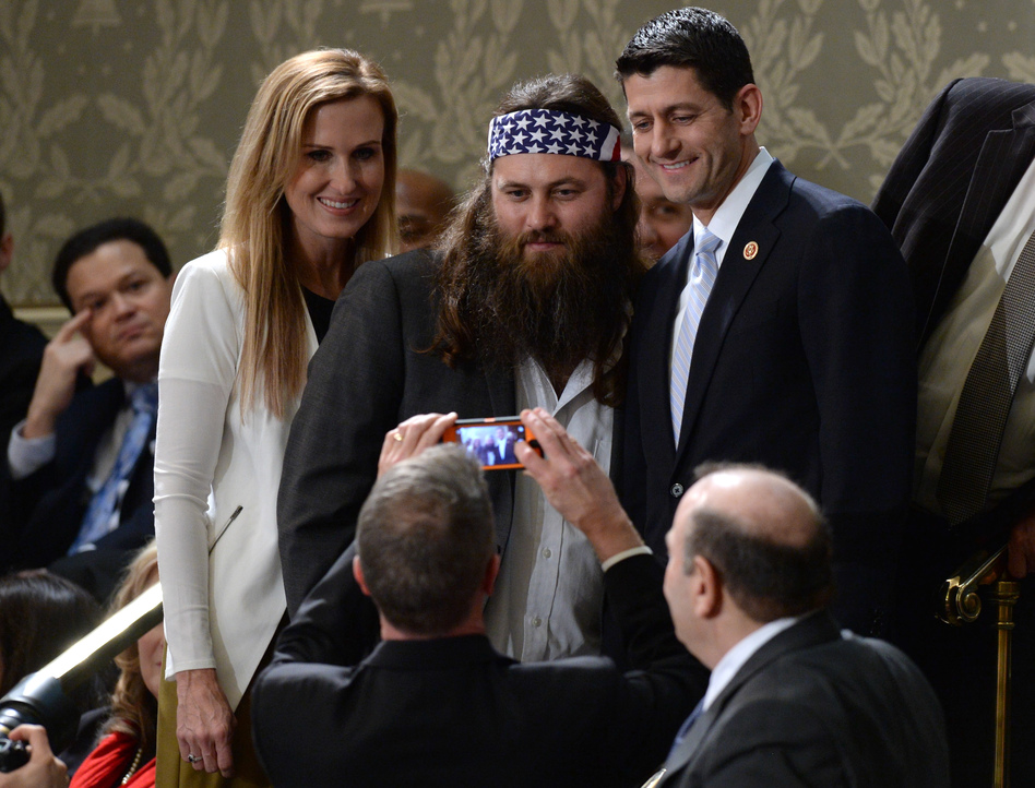 Korie Robertson (left) and Willie Robertson of the television show Duck Dynasty pose for a picture with Rep. Paul Ryan, R-Wis. (AFP/Getty Images)