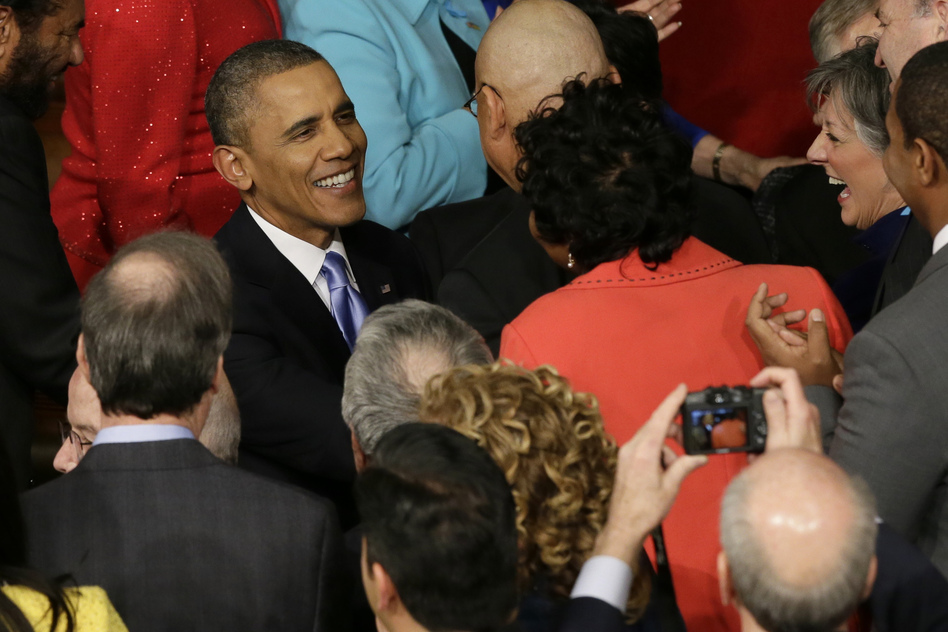 Obama is greeted by lawmakers as he arrives to give his address. (AP)