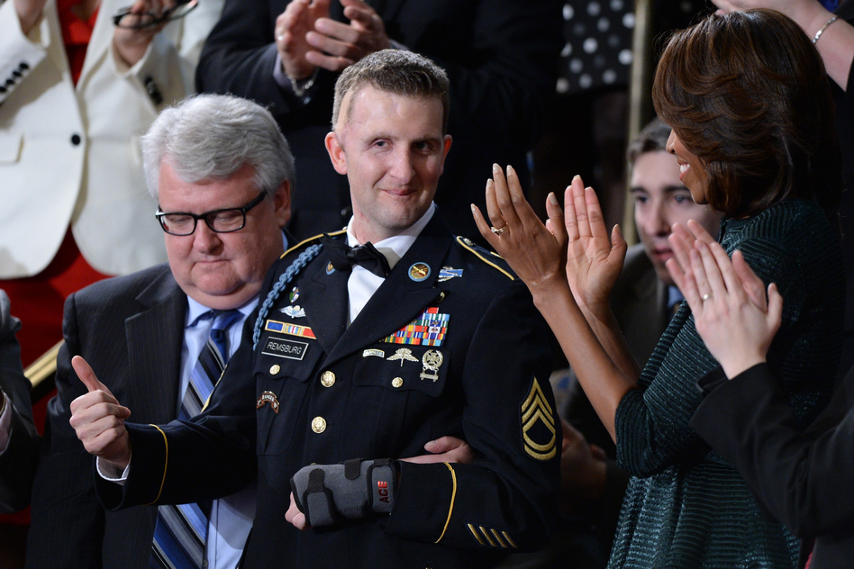 Army Ranger Cory Remsburg, who was wounded in Afghanistan, gives the thumbs up as Obama speaks about him in the final portion of the address. (AFP/Getty Images)