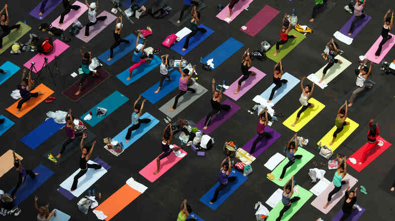 People practice yoga at a fundraiser for a breast cancer foundation in Hong Kong.