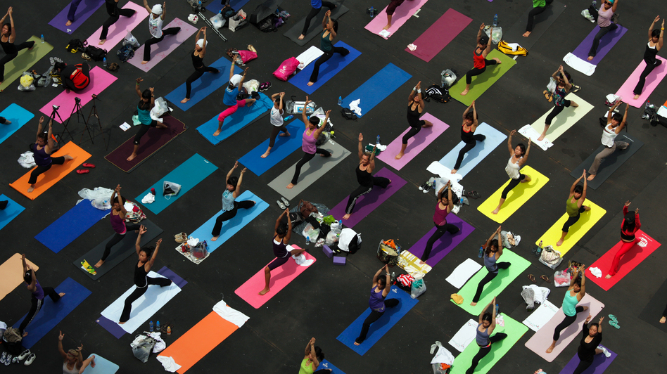 People practice yoga at a fundraiser for a breast cancer foundation in Hong Kong. (Ed Jones/Getty Images)