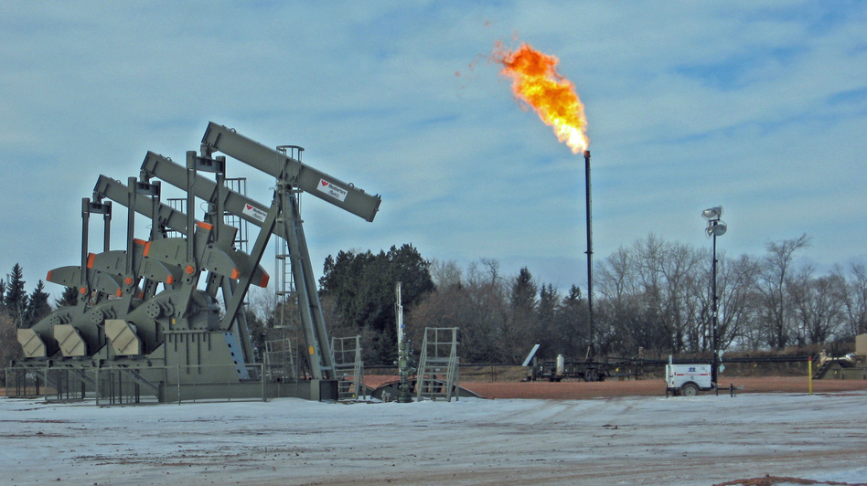 Gas flaring near Keene, N.D. Analysts estimate that almost 30 percent of the gas being produced in the state is burned off. (NPR)