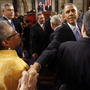 President Obama shakes hands after giving the State of the Union address before a joint session of Congress on Tuesday.