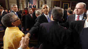 President Obama shakes hands after giving the State of the Union address before a j