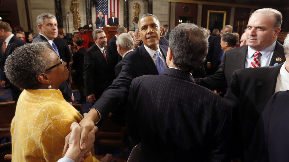 President Obama shakes hands after giving the State of the Union address before a joint session of Congress on Tuesday. (Larry Downing/AP)