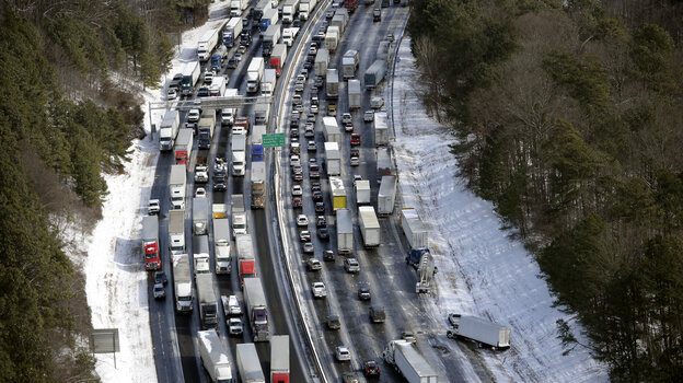 """Traffic is snarled along the I-285 perimeter north of Atlanta's metro area Wednesday. Georgia Gov. Nathan Deal has called Tuesday's snow storm """"unexpected"""" — prompting a response from weather forecasters."""