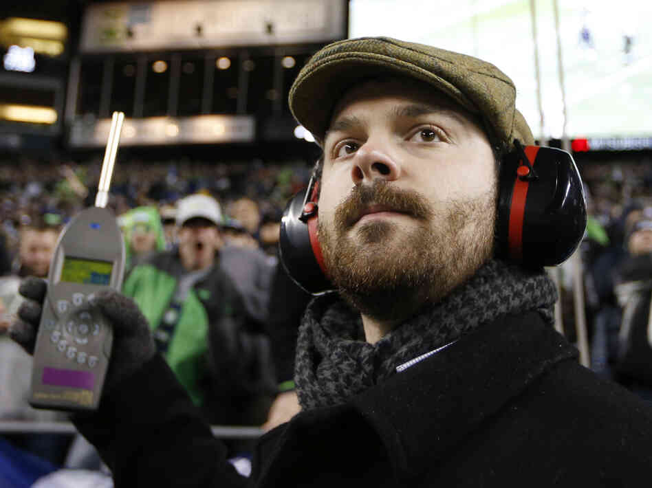 Matt Roe, an acoustical consultant with SSA Acoustics, measures noise levels in CenturyLink Field during an the Seattle Seahawks game against the New Orleans Saints on Dec. 2. Fans set a Guinness World Record for loudest crowd roar during that game, clocking in at 137.6 decibels.