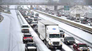 A winter storm dumped snow Tuesday along Interstate 20/59 near downtown Birmingham and on other parts of central and southern Alabama.
