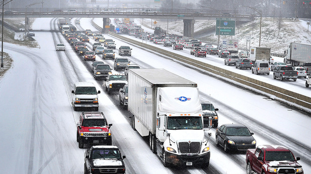 A winter storm dumped snow Tuesday along Interstate 20/59 near downtown Birmingham and on other parts of central and southern Alabama. (Al.com /Landov)