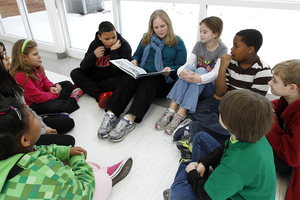 Joyce Cook, an instructional aide, reads Snowflake Bentley to a group of fifth-graders stranded at Oak Mountain Intermediate School because of snow and ice in Indian Springs, Ala.