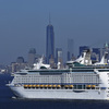 The New York skyline is seen in a distance as Royal Caribbean's Explorer of the Seas enters New York harbor on Wednesday after a massive ship-borne outbreak.