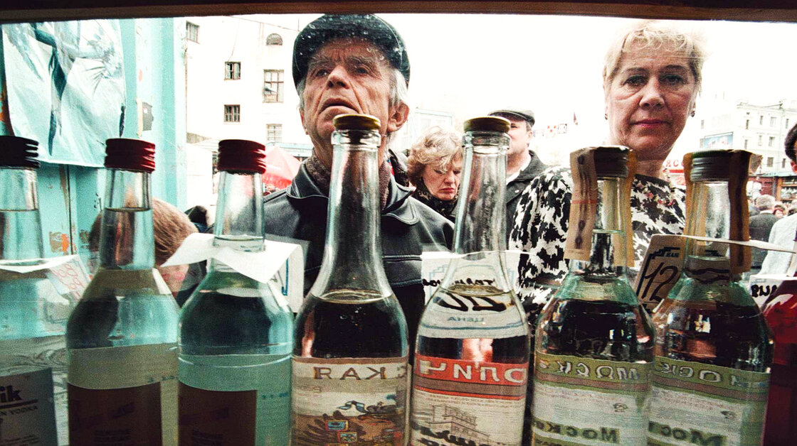 Shoppers check out vodka in a street kiosk in Moscow in 2008.