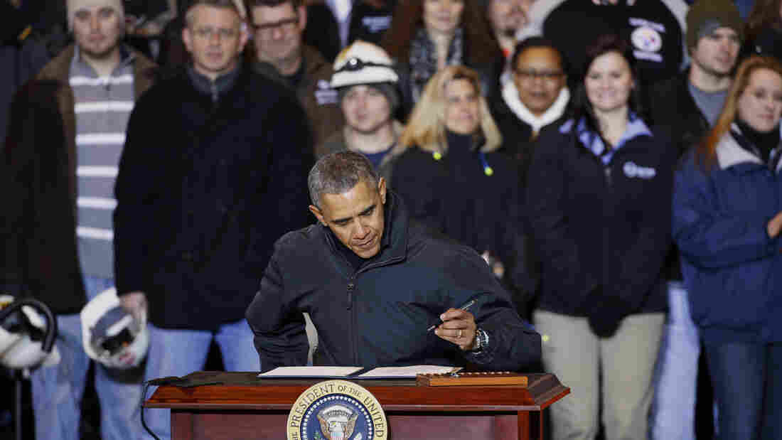 President Obama prepares to sign an executive order mandating that federal contractors be required to raise the minimum wage they pay their workers to $10.10, at the end of a Jan. 29 appearance at the US Steel's Mon Valley Works in West Mifflin, Pa.