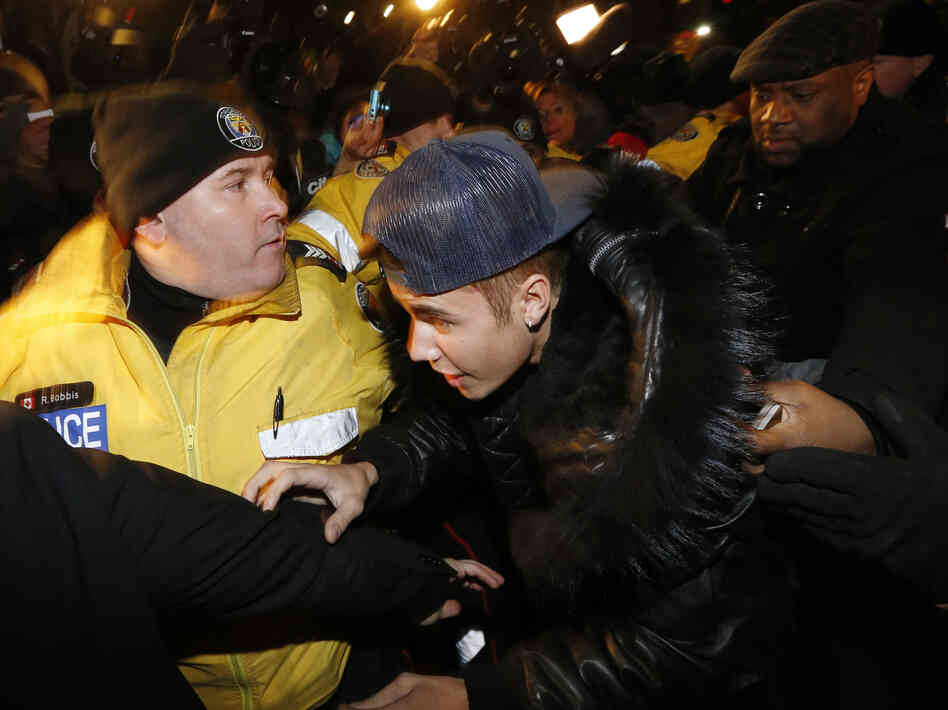 There was quite a commotion Wednesday night in Toronto when pop star Justin Bieber (center) arrived at a polic
