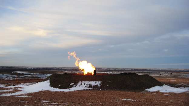 Gas flaring near Highway 85 southwest of Williston. Analysts estimate that almost 30 percent of the gas being produced in the state is burned off. (Jeff Brady/NPR)