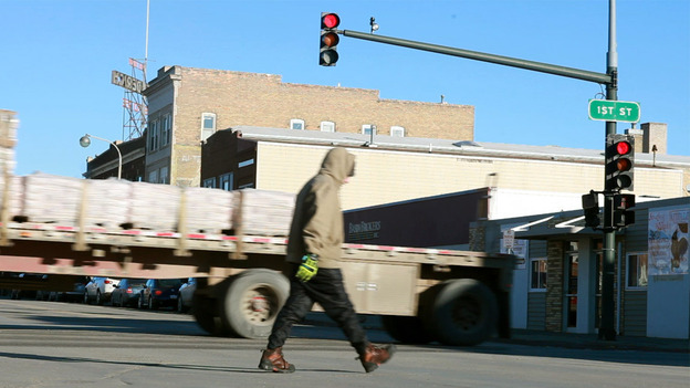 The small streets of Williston, N.D., are bustling with trucks early in the morning. (Annie Flanagan for NPR)
