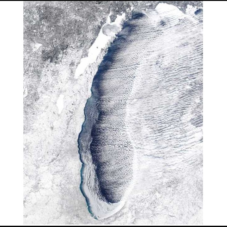 Lake Michigan, now partially frozen, is chilling from above.
