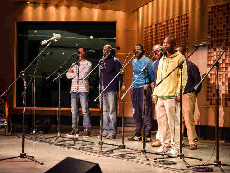 "Many of the group members are related. Albert Mazibuko (second from left) proudly watches his nephew Babuyile Shabalala introduce the song ""Vimba."" Babuyile is also the grandson of the group's founder, Joseph Shabalala."