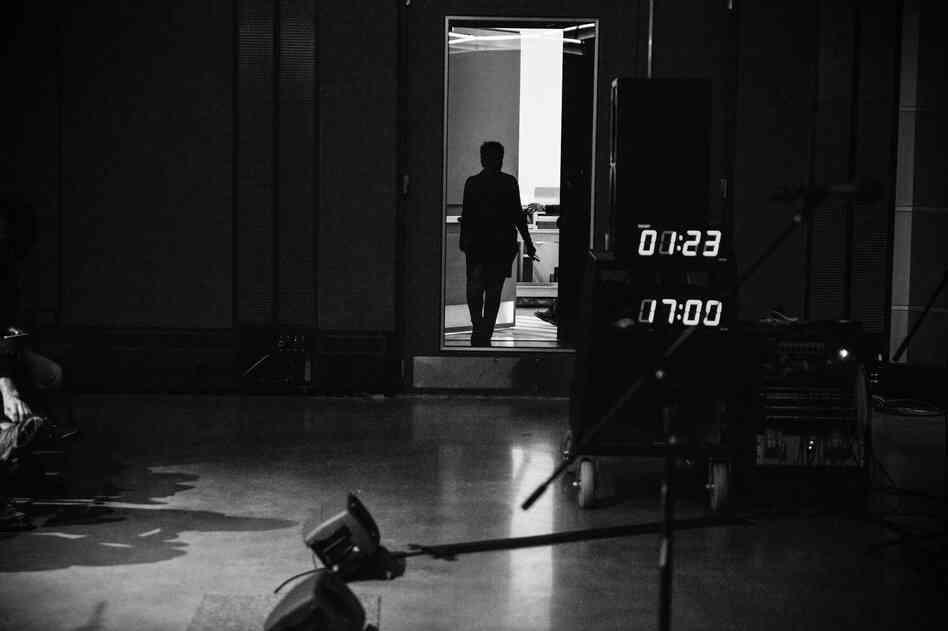 Host Michel Martin walks into Studio 1.