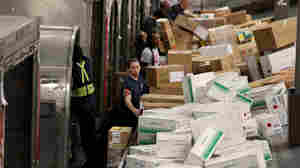 "FedEx employees sorted through mounds of packages in December at one of the company's facilities in Miami. Consumer spending helped fuel the economy in the third quarter. Gross domestic product grew at a 3.2 percent annual rate (a figure that adjusts for holiday spending to show the ""real"" growth)."