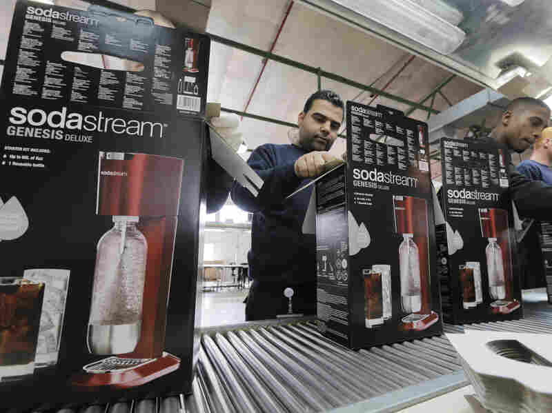 Employees pack boxes of SodaStream products at the company's factory in the West Bank Jewish settlement of Ma'ale Adumim on Jan. 28.