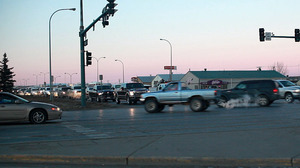 Trucks crowd a busy intersection during rush hour in Williston, N.D.