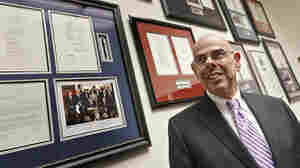 Democratic Rep. Henry Waxman of California stands in his Capitol Hill office beside a wall displaying his legislative accomplishments. Waxman, 74, said Thursday that he would retire after 40 years in the House of Representatives.
