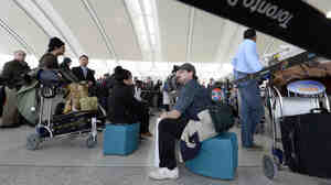 Travelers at Pearson International Airport in Toronto earlier this month. At an unnamed airport, Canada's spy agency tested a program that allowed them to track those who took advantage of free Wi-Fi.