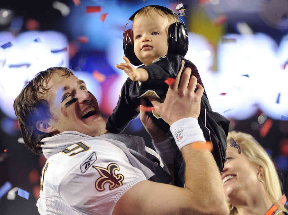 For some hearing experts like speech-language pathologist Nancy Alarcon, this 2010 photo of New Orleans Saints' Drew Brees holding his son, with earmuffs on, captures the importance of wearing hearing protection during games.