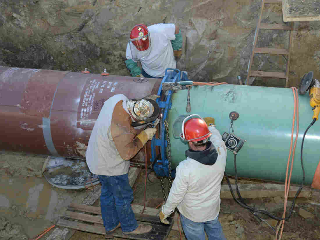 Pipefitters work on construction of the Keyst
