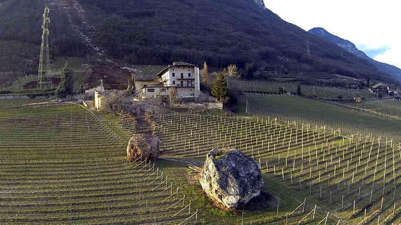 Years ago, the boulder in the foreground broke loose and rolled on to this farm in northern Italy. Then this month, the boulder in the center of the photo tumbled down the mountain, tore through a barn and came to rest in a field. Fortunately, no one was hurt.