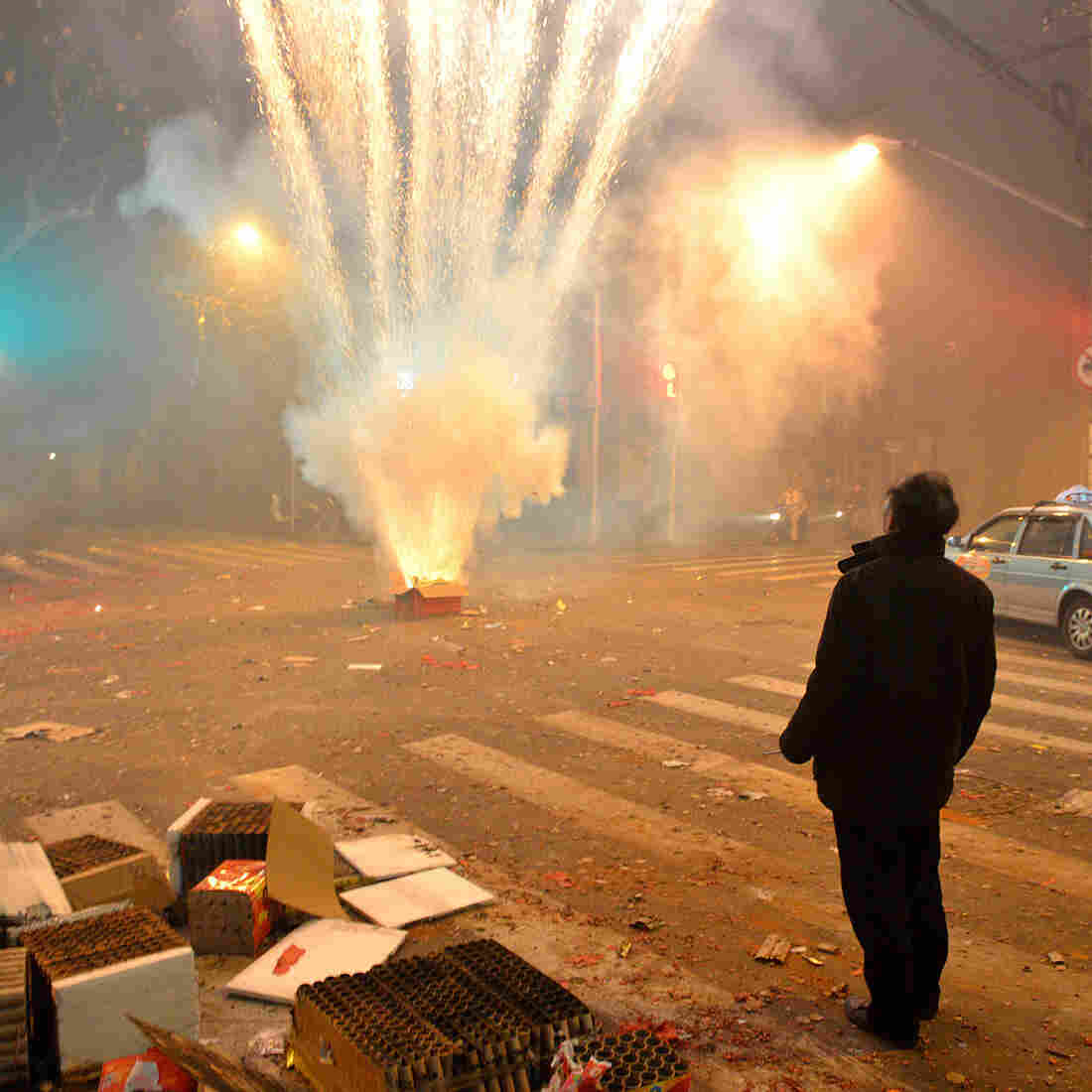 Fireworks explode in a Shanghai street on Thursday, the eve of the Lunar New Year. Setting off firecrackers is meant to ward off evil spirits and bring good luck. But many Chinese say they won't buy firecrackers this year, owing to growing worries about air quality.