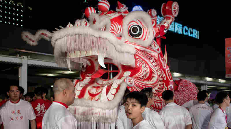 Performers get ready before the start of a Chinese New Year parade in Hong Kong on Jan. 31.