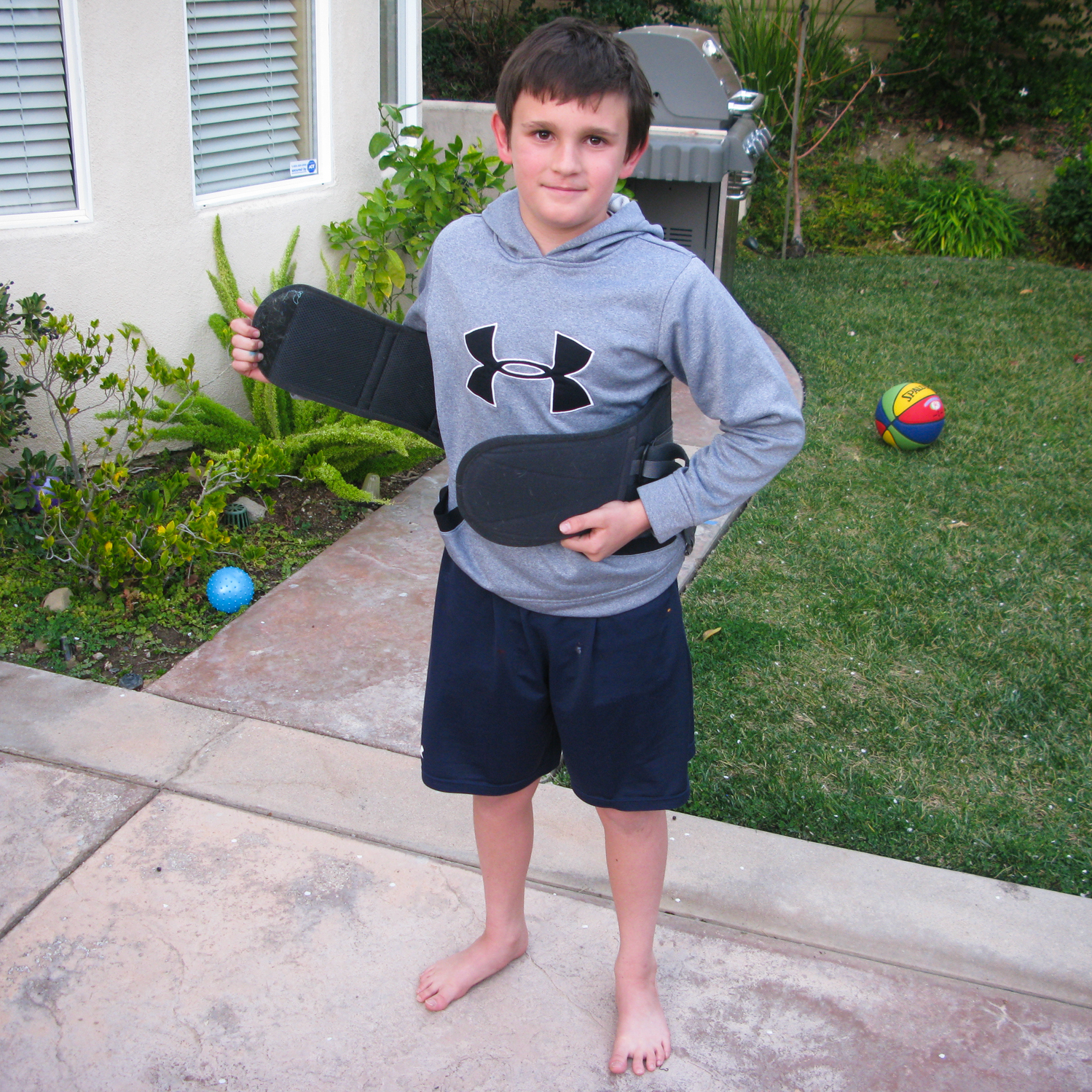At age 10, Jack Everett has to wear a brace because of a fracture in his back.