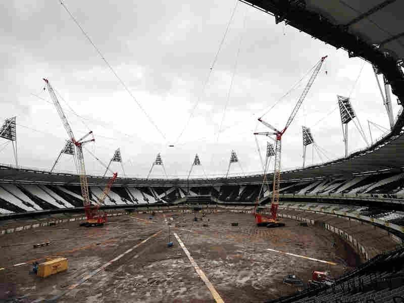 Cranes sit idle at the Queen Elizabeth Olympic Park Stadium in London on Nov. 11, 2013. Weather delayed work to transform it into a year-round multi-use venue, the home of West Ham United Football Club and the new national competition stadium for UK Athletics.