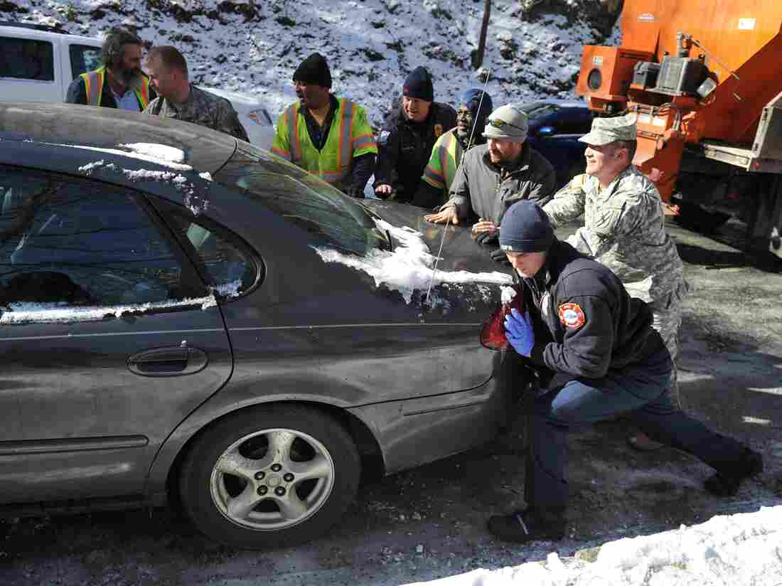 Contractors, volunteers and members of the Georgia National Guard helped move this car on Thursday. It was one of more than 2,000 vehicles abandoned Tuesday when a wicked winter storm left roads covered in ice.