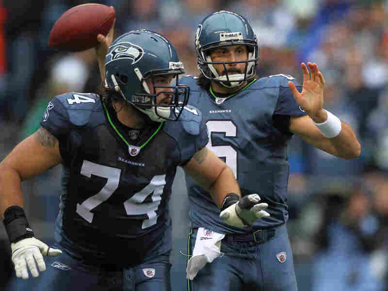 John Moffitt, #74, protects Seattle Quarterback Charlie Whitehurst in a 2011 game versus the Cincinnati Bengals.