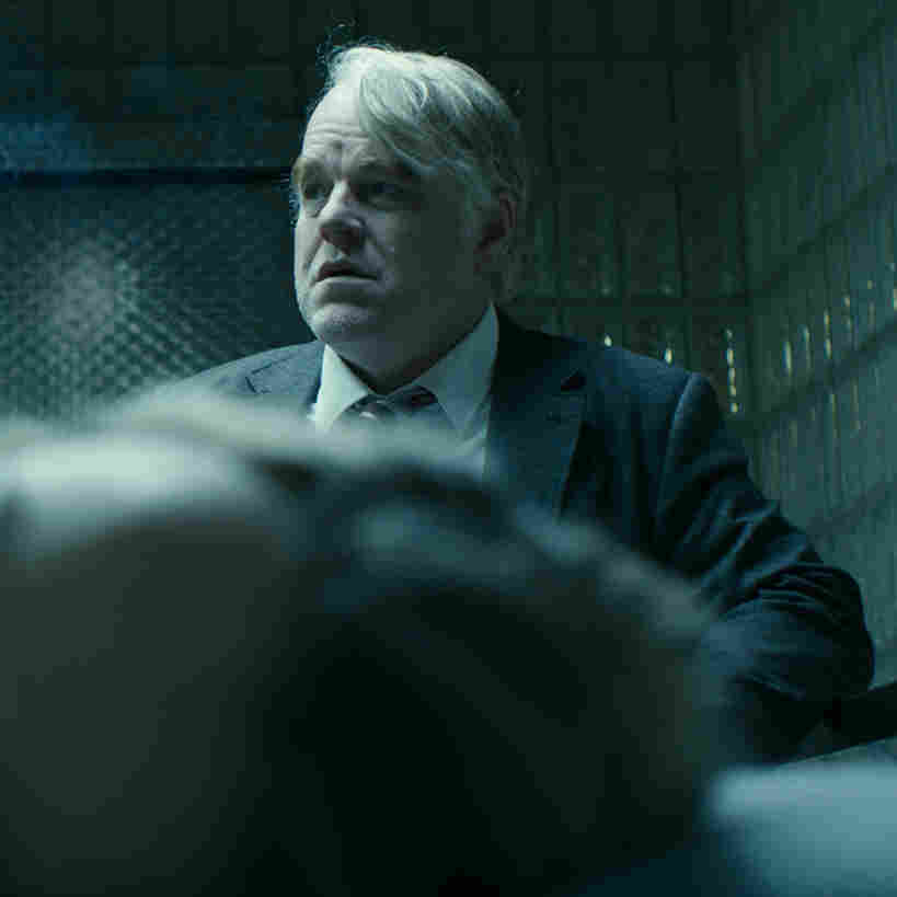 Philip Seymour Hoffman (right) and Rachel McAdams (front) in a scene from the film A Most Wanted Man, which premiered at the 2014 Sundance Film Festival.