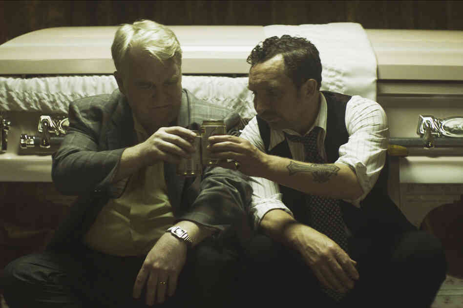 Hoffman (left) and Eddie Marsan, in a scene from the film God's Pocket, released in January.