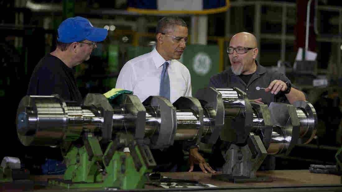 President Barack Obama looks at a crank shaft as he tours General Electric's Waukesha Gas Engines facility on Thursday in Waukesha, Wis. as part of a four-stop tour he is making to expand on themes from his State of the Union address, including the economy.