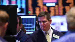 Traders work on the floor of the New York Stock Exchange at the end of the trading day on Monday in New York City.