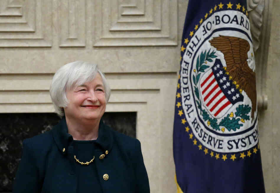 Janet Yellen smiles Monday before being sworn in
