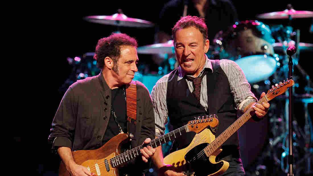 Nils Lofgren (left) with Bruce Springsteen.
