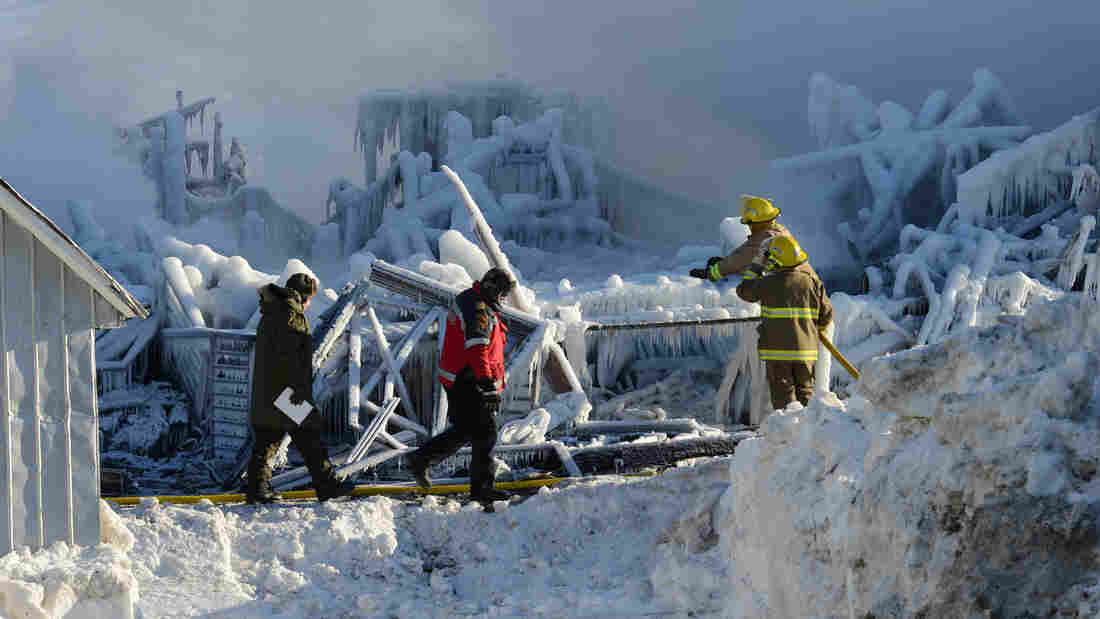 Jan. 23: Ice covers the remains of a home for seniors in L'Isle-Verte, Quebec. A fire there killed at least 27 people. Authorities fear another five people also died.