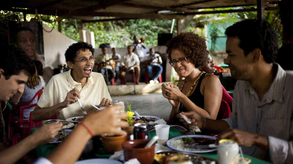 Residents enjoy a meal at the Quilombo Sacopa in Rio de Janeiro in 2012. Brazil has some 3,000 quilombo communities, which were formed by runaway slaves, dating to the 19th century. Residents have been promised ownership of their land but say the legal process has moved slowly.