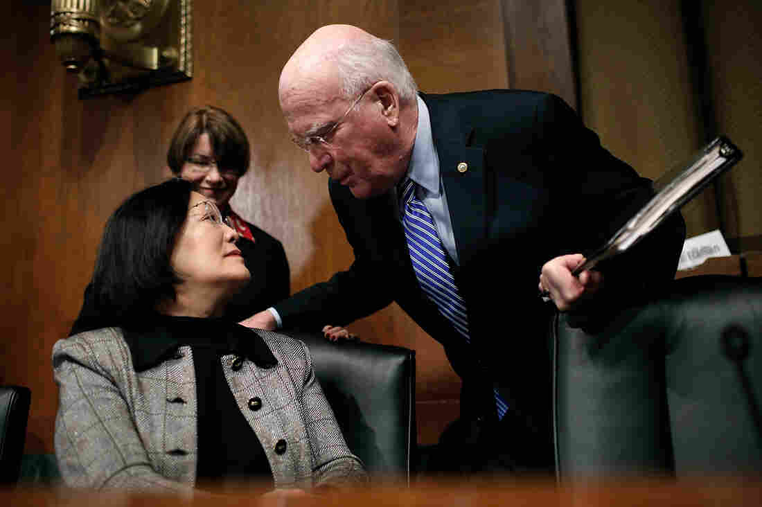 Sen. Patrick Leahy chats with Sen. Mazie Hirono before hearing from retail company executives on Tuesday.