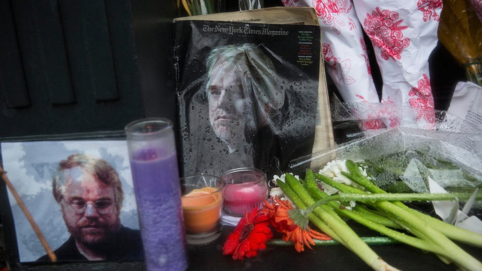 Candles, flowers and portraits lie in the rain outside Philip Seymour Hoffman's apartment in New York City.